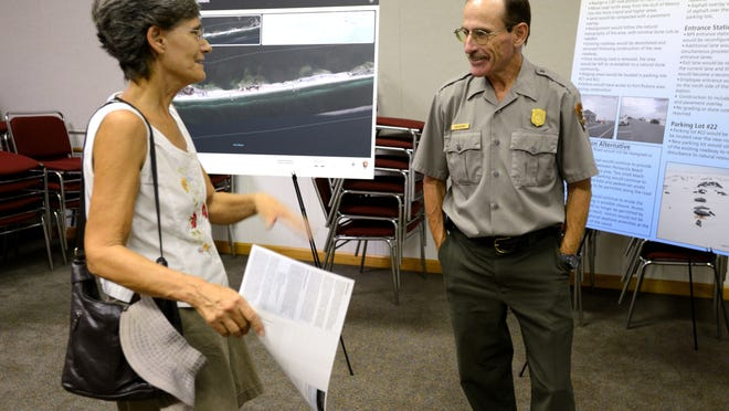 Cara Rinelli talks with Dan Brown, Gulf Islands National Seashore Superintendent, during an open house Tuesday about a proposed plan to realign Fort Pickens Road to protect it from recurring weather events.