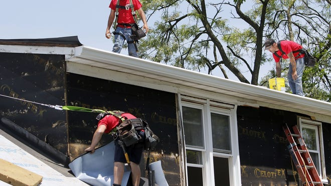 Bo Lacey Construction's Jonathan Siesky, Mike Gray and Theodore Heils work on a roofing project on S. Countryside Drive Tuesday, June 2, 2020. Tom E. Puskar, Times-Gazette.com