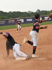 Benton's Sam Simmons is safe at third in their game against Belle Chasse Saturday at Benton.
