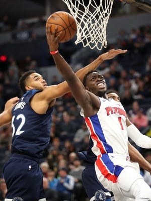 Pistons guard Reggie Jackson (1) shoots as Timberwolves center Karl-Anthony Towns (32) defends during the second half of the Pistons' 100-97 win on Sunday, Nov. 19, 2017, in Minneapolis.