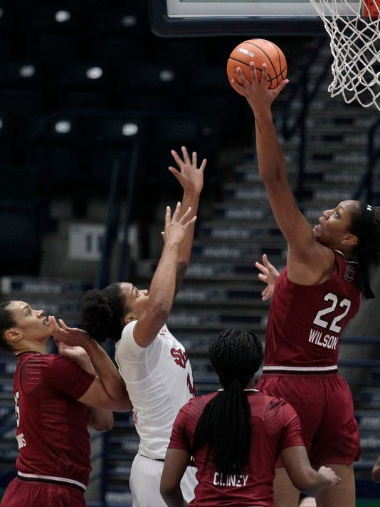 South Carolina's A'ja Wilson (22) wrestles with St. John's Maya Singleton, second left, for a loose ball as teammates South Carolina's Alexis Jennings, left, Doniyah Cliney, third from left, defend during the first quarter of the Gulf Coast Showcase basketball tournament, Saturday, Nov. 25, 2017, in Estero, Fla. (AP Photo/Luis M. Alvarez)