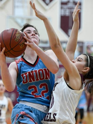 Union County's Jralee Roberson (22) shoot a layup over Henderson's Katie Rideout (10) as the Henderson County Lady Colonels play district rival the Union County Braves at Colonel Gym Monday, January 22, 2018.