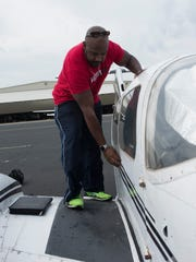 Flight student, Ernest Poe, prepares to run through a pre-flight check of an aircraft before take off, Thursday April 26, 2018.