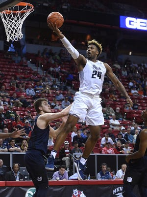Nevada's Jordan Caroline drives to the basket during a game against Utah State last season.