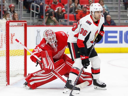 Senators center Colin White (36) skates in front of Red Wings goaltender Jimmy Howard (35) during the first period on Saturday, March 31, 2018, at Little Caesars Arena.