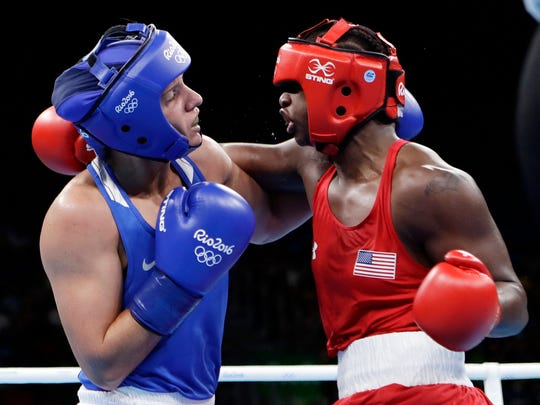 Russia's Yaroslava Yakushina, left, and United States' Claressa Shields exchange punches during a women's middleweight 75-kg quarterfinals boxing match at the 2016 Summer Olympics in Rio de Janeiro, Brazil, Wednesday, Aug. 17, 2016.