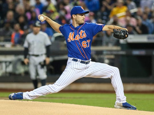 New York Mets pitcher Seth Lugo (67) pitches against the New York Yankees in the first inning at Citi Field.