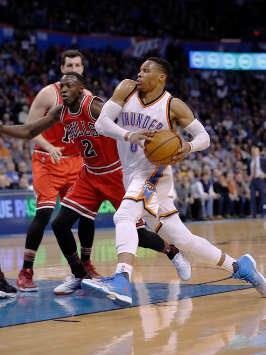 Oklahoma City Thunder guard Russell Westbrook (0) drives to the basket around Chicago Bulls guard Jerian Grant (2) during the first half of an NBA basketball game in Oklahoma City, Wednesday, Feb. 1, 2017. (AP Photo/Alonzo Adams)