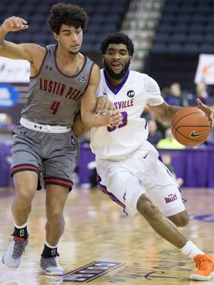 Evansville's K.J. Riley (33) drives against Austin Peay's Dayton Gumm (4) during the first half at the Ford Center Saturday afternoon. The Purple Aces beat the Governors 78-74 in overtime to improve to 9-2 on the season.
