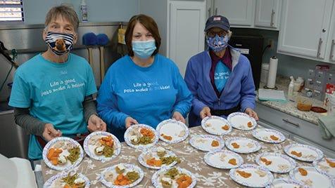 From left, Julie Keck, Shelley Shepherd, and Nancy Wagner prepare Thanksgiving pet treats.