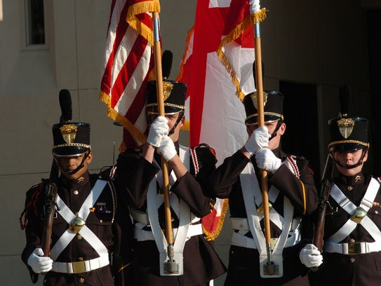 An honor guard from Marion Military Institute .