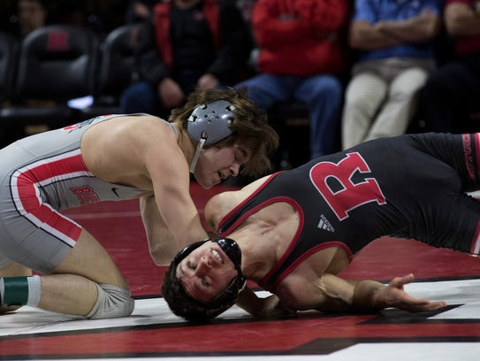 Rutgers' Nick Suriano works for an escape against Ohio