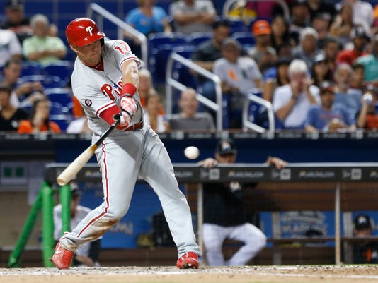Philadelphia Phillies' Rhys Hoskins gets a base hit during the fifth inning of a baseball game against the Miami Marlins, Thursday, Aug. 31, 2017, in Miami. Hopkins, single extend his hitting streak to 13 games. The Phillies defeated the Marlins 3-2. (AP Photo/Wilfredo Lee)