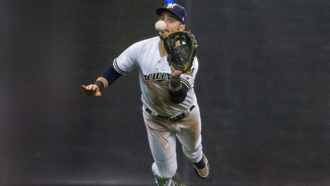 """Ryan Braun flies through the air for a catch in 2017. In 2018, he'll be profiled as """"Braun Solo"""" for a Brewers Star Wars theme night. It's the fourth year the Brewers have done a Star Wars night."""