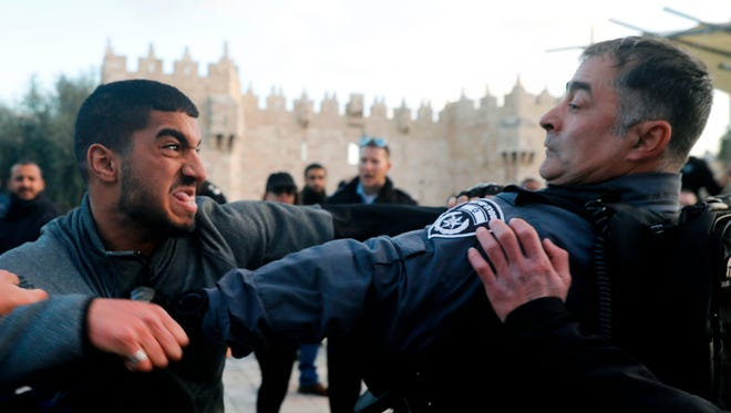 Israeli police scuffle with a Palestinian protestor outside Damascus Gate in Jerusalem's Old City on Dec. 7, 2017.