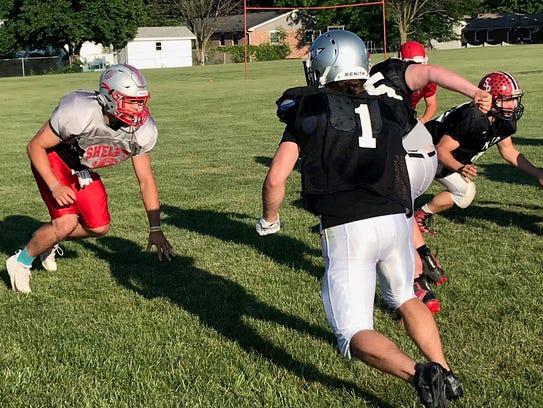 Shelby defensive end Carter Brooks (left) prepares