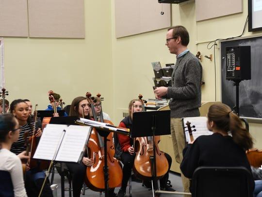Orchestra teacher Mike Hayden talks to his class.