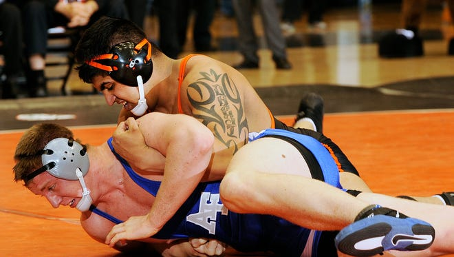 Oregon State's Amarveer Dhesi (top) is ranked No. 10 nationally in the heavyweight division
