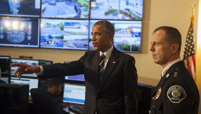 President Barack Obama tours Camden County Police Department headquarters with Chief Scott Thomson in May 2015.