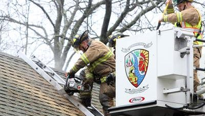 Toms River firefighters train at a house about to be demolished on Cranmoor Drive in 2014.