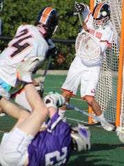 Brother Rice goalie Jack Michael makes a save on Bloomfield