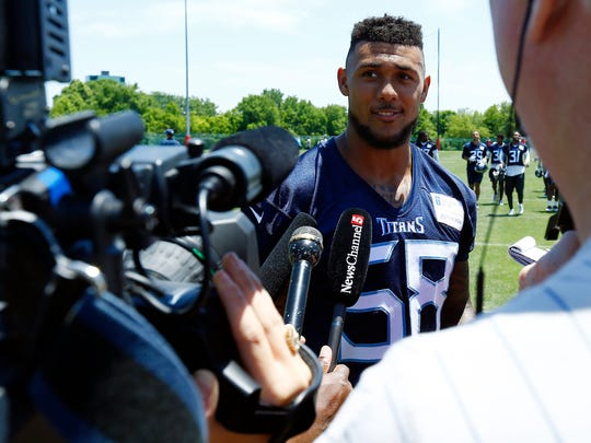 Titans Harold Landry talks with reporters after practice