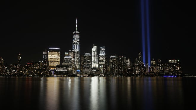 In this Sept. 11, 2017, file photo, the Tribute in Light illuminates in the sky above the Lower Manhattan area of New York, as seen from across the Hudson River in Jersey City, N.J.