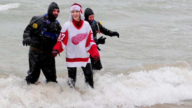 Kimberly Bowman, of St. Clair, was last out of the water during the Kiwanis Polar Bear Plunge on Saturday at Lakeside Beach in Port Huron.