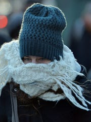 A woman bundled against the bitter cold.