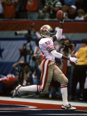 John Taylor of the San Francisco 49ers runs in the end zone for a touchdown in Super Bowl XXIV against the Denver Broncos at Louisiana Superdome on January 28, 1990 in New Orleans, Louisiana.  The 49ers won 55-10.