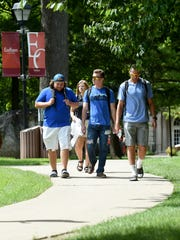 Students walk across the Earlham College campus on Aug. 24, 2016, in Richmond.