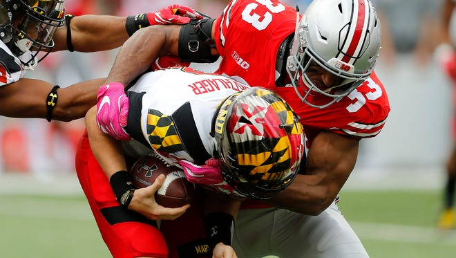 Ohio State linebacker Dante Booker sets the tone for Saturday's 62-14 rout with a sack of quarterback Max Bortenschlager on Maryland's first play from scrimmage.