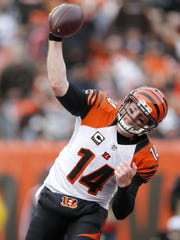 Andy Dalton spikes the ball after scoring a touchdown against the Cleveland Browns on Dec. 6, 2015.