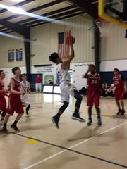 Marshall Academy's Jordan Morrison goes up for a layup
