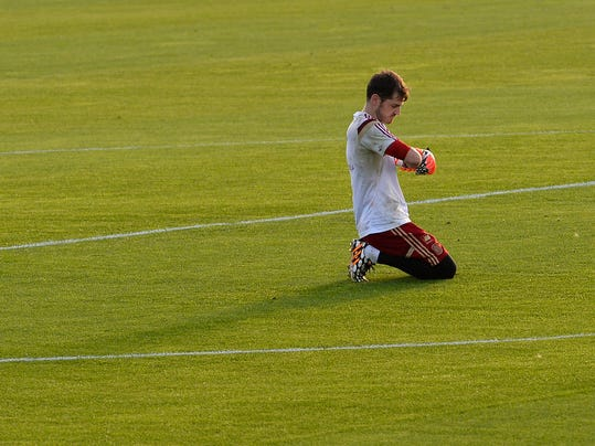 Spain's goalkeeper Iker Casillas adjusts his gloves during a training session at he Atletico Paranaense training center in Curitiba, Brazil, Saturday, June 14, 2014. Spain will play in group B of the Brazil 2014 World Cup. (AP Photo/Manu Fernandez)