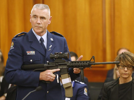 Police Sr. Sgt. Paddy Hannan shows New Zealand lawmakers in Wellington Tuesday, April 2, 2019, an AR-15 style rifle similar to one of the weapons a gunman used to slaughter 50 people at two mosques. New Zealand lawmakers on Tuesday voted overwhelmingly in favor of new gun control measures during the first stage of a bill they hope to rush into law by the end of next week. (AP Photo/Nick Perry)