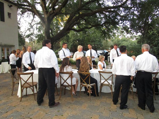 Guests pose to recreate the famous Rodrigue painting,