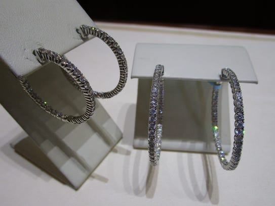 The large hoops are 4 carats of diamonds set in white