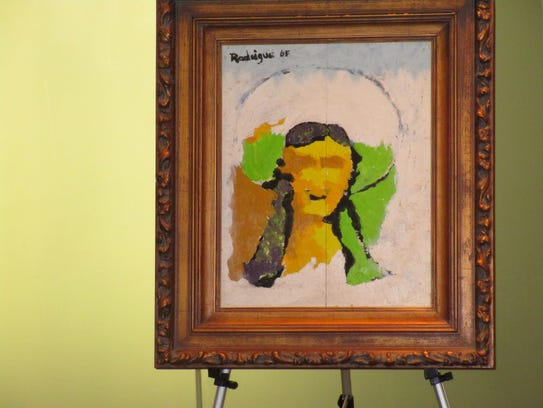 Works by George Rodrigue were on display for a book
