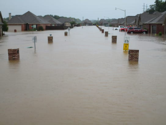 A flooded street in the Highland Ridge neighborhood