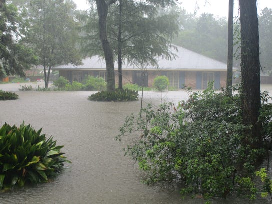 A flooded home on Acacia Drive in Lafayette.