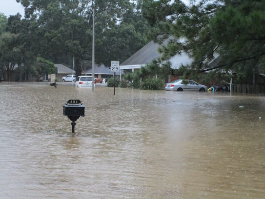 Homes and cars flooded in Lafayette.