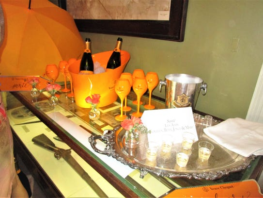 A side table set for Vignettes featuring fine champagne.