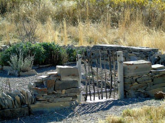 Dry-stack fences guard Jessie Ferguson's herb garden.