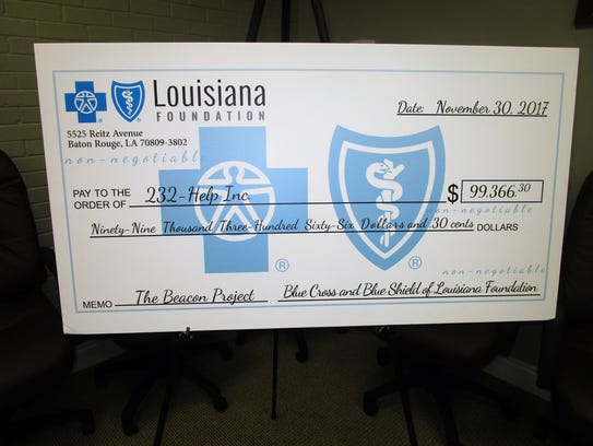 Blue Cross, Blue Shield presented a check for nearly