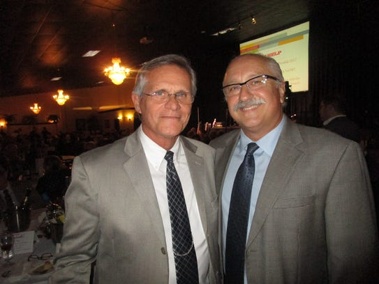 District Attorney Keith Stutes, left, and Lafayette Parish Clerk of Court Louis Perret.