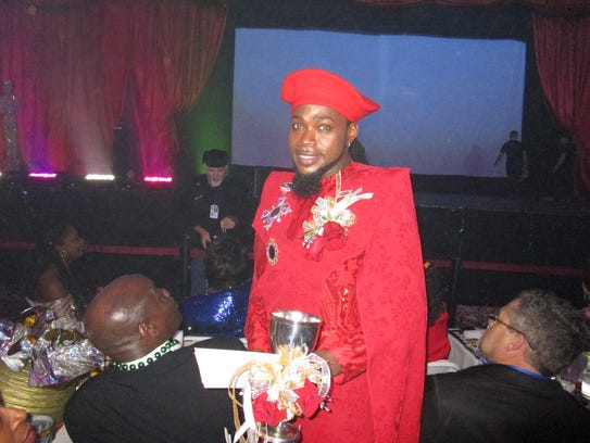 King Apollo, Olajuwan Alexander, greets guests before the ball begins at the Cajundome Convention Center.