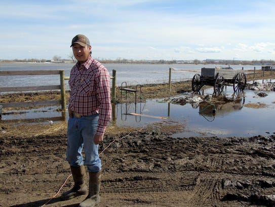 Branden Hammond, a young Harlem farmer, had his barley field flooded, along with his yard. Sandbags were keeping water from his road, mostly, but he was bracing for higher water.