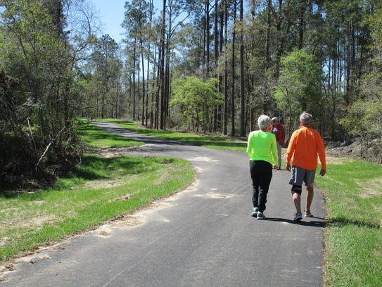 New Segment: Walkers enjoy the newly paved trails leading