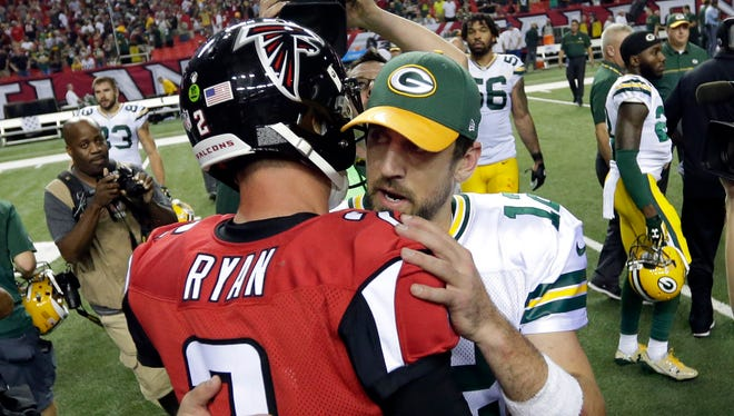 Green Bay Packers quarterback Aaron Rodgers (12) talks with Atlanta Falcons counterpart Matt Ryan (2) after a 33-32 loss  at the Georgia Dome.